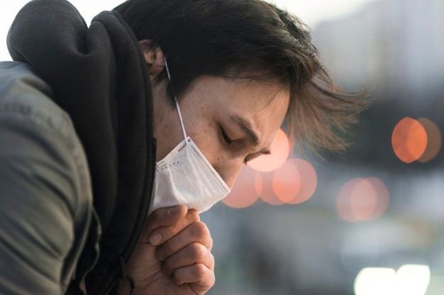 Pessoa tossindo.jpg